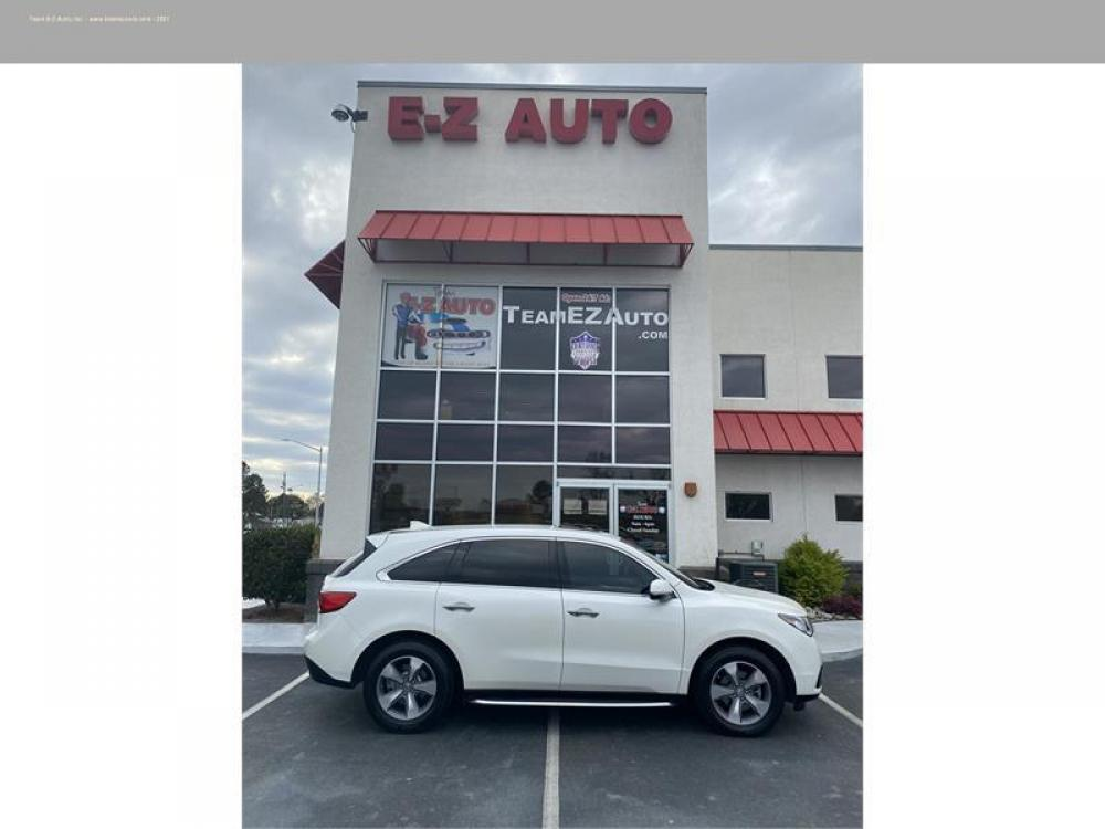 2016 White /Tan Acura MDX (5FRYD3H21GB) with an 6 3.5L V6 F SOHC 24V engine, Automatic transmission, located at 3900 Bragg Blvd., Fayetteville, 28303, (910) 868-3000, 35.081905, -78.943367 - Photo #1